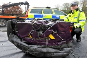 police crush uninsured cars